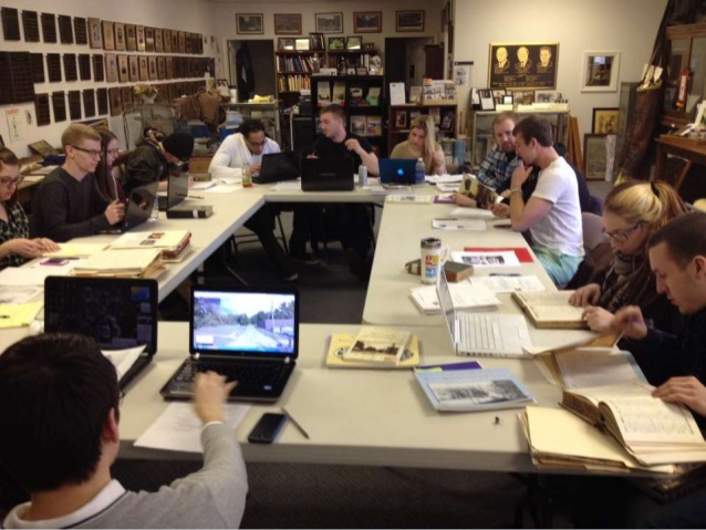 "A photo of my students ""in action"" - selecting images from the archives of the historical society back in March. We set up 24 computer stations one Saturday and worked all day in their digital images – it was a fun time!"